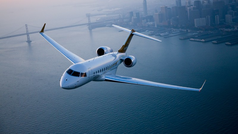 Global Express in flight over city